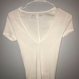 URBAN OUTFITTERS white low v neck shirt